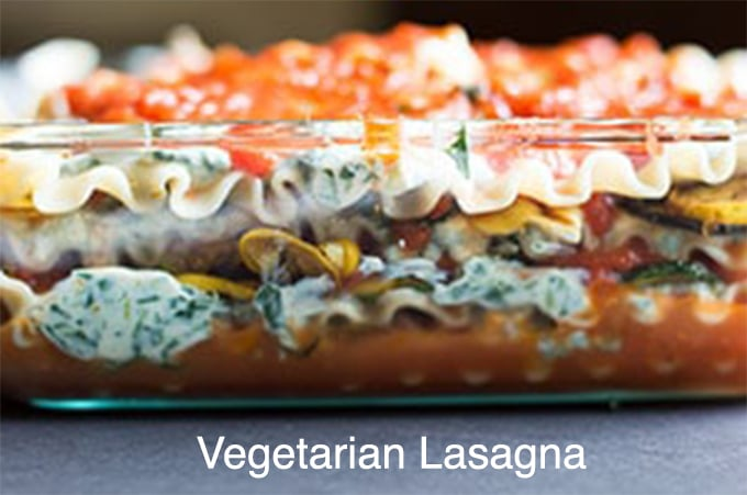 Side view of the layers of vegetarian lasagna in a glass casserole dish