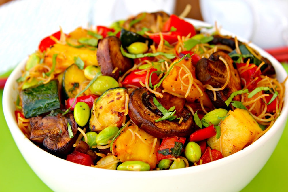 Vegan Aloha Noodle Bowl ~ Grilled pineapple, zucchini, and red peppers then quickly stir-fried with mushrooms, edamame, rice noodles, and a sweet-spicy sauce for quick and utterly delicious dinner ~ The Complete Savorist