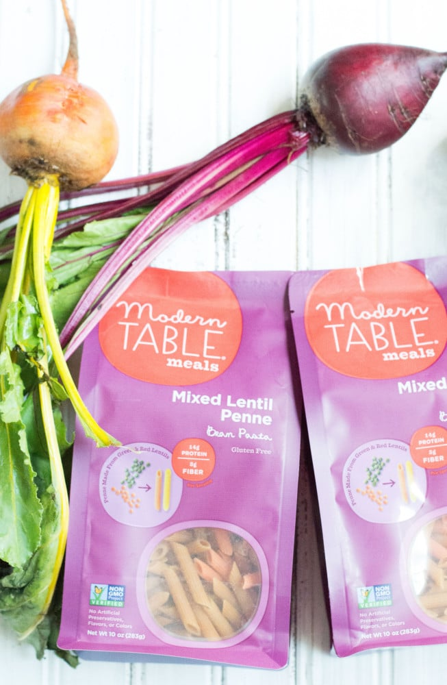 Top view of beets and Modern Table Pasta in packages