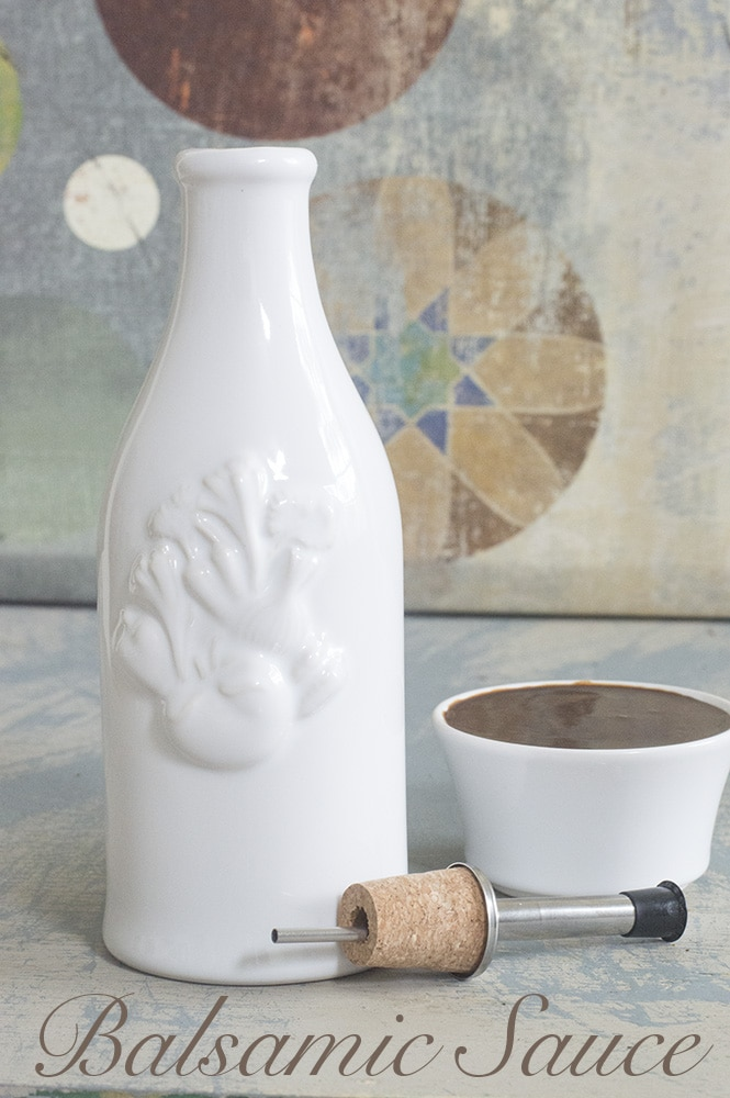 A porcelin Dressing bottle with a ramekin on the side filled with balsamic sauce - Vegan Tapas