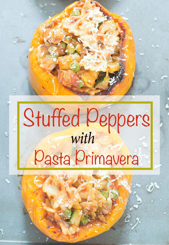 overhead view of stuffed peppers with pasta primavera