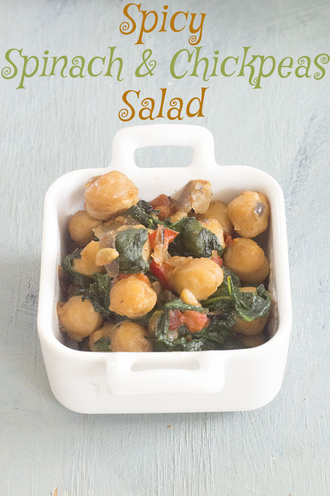 spicy spinach and chickpeas salad in a square ramekin - vegan tapas