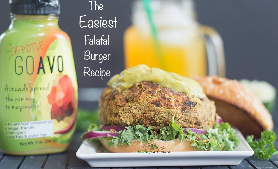 Closeup view of falafal burger with GoAvo bottle next t it