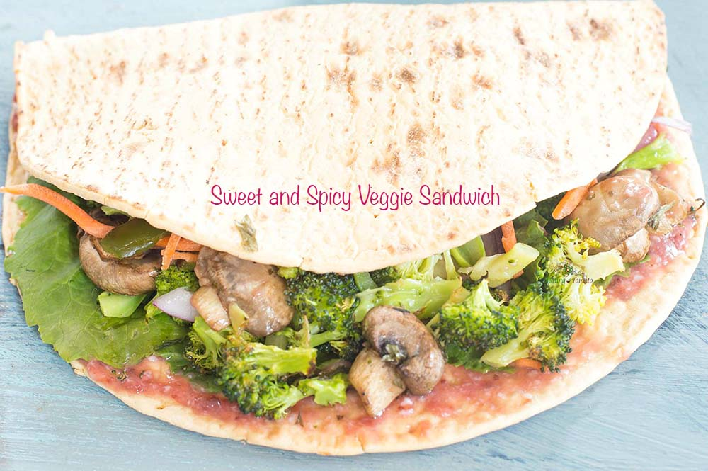 30° view of a flatbread filled with roasted veggies - Sweet and Spicy Veggie Sandwich