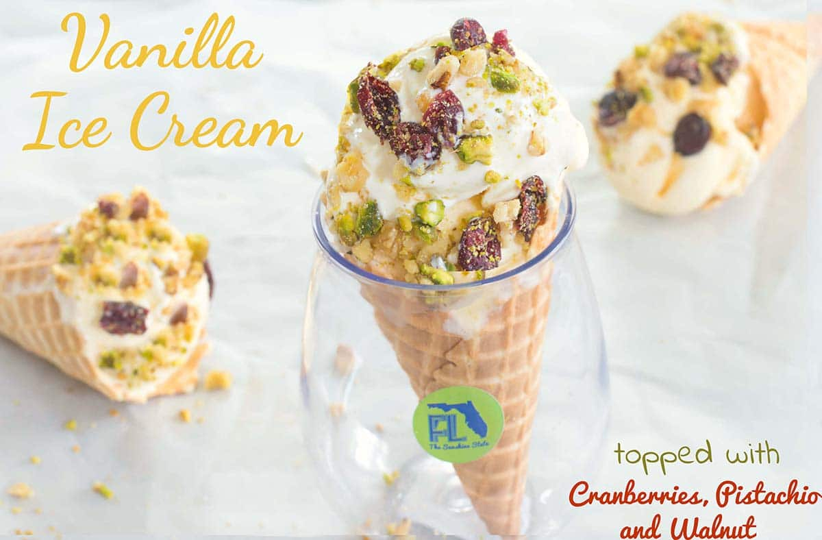Mayfield Homemade Vanilla Ice Cream topped with Walnuts, Cranberries & Pistachios. Take the ice cream experience to a whole new level by putting it in cones