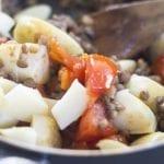Closeup of Potatoes put into the pan - Lentil Potato Medley