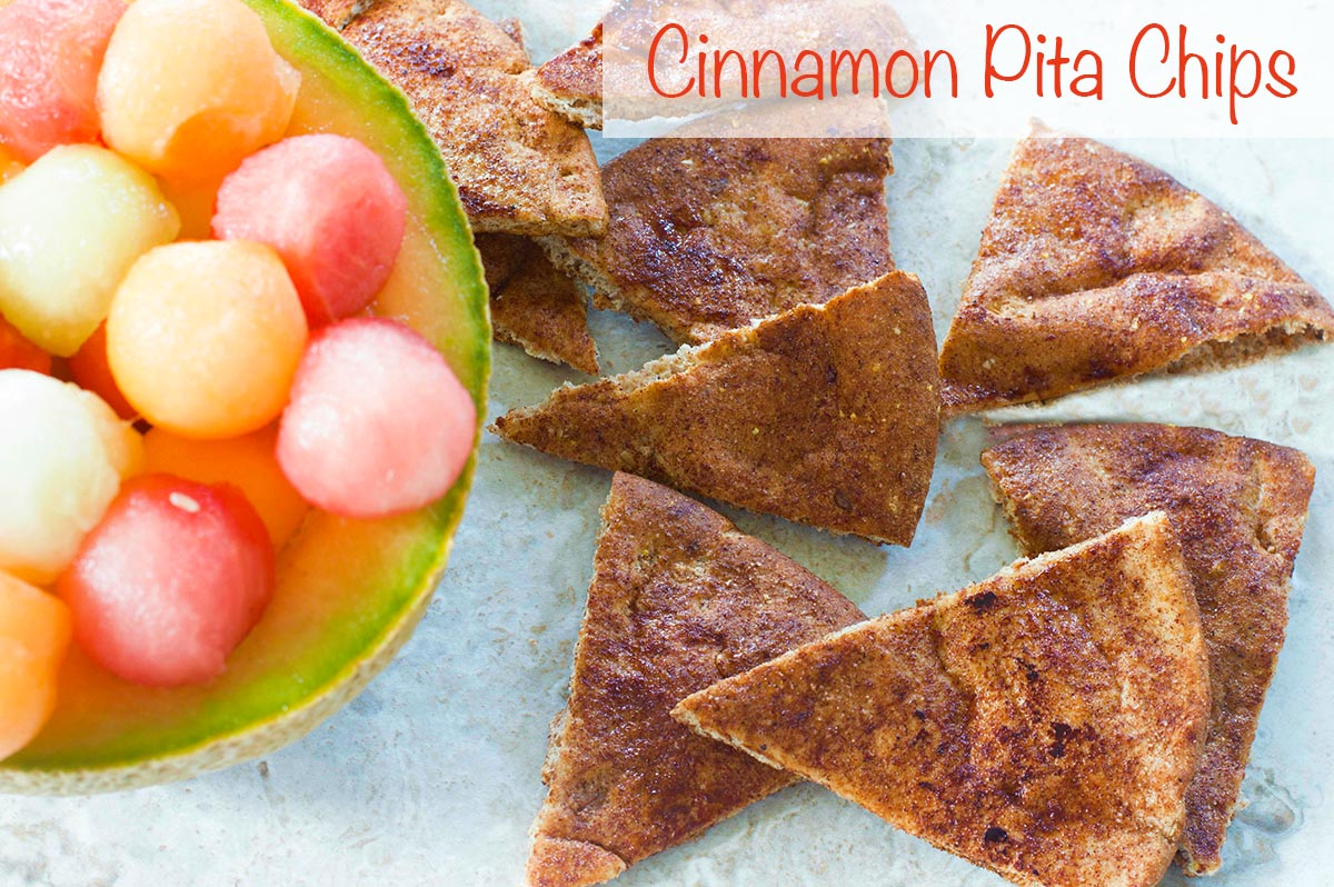 Overhead view of cinnamon pita chips next to a cantoloupe with melon balls