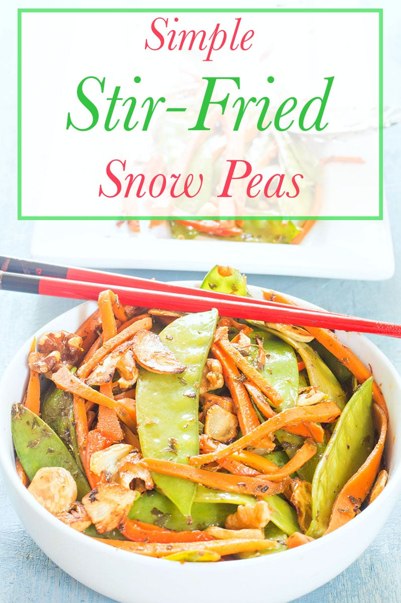 Closeup view of A White bowl with snow peas, carrots and ginger stir fried. Chopsticks on top
