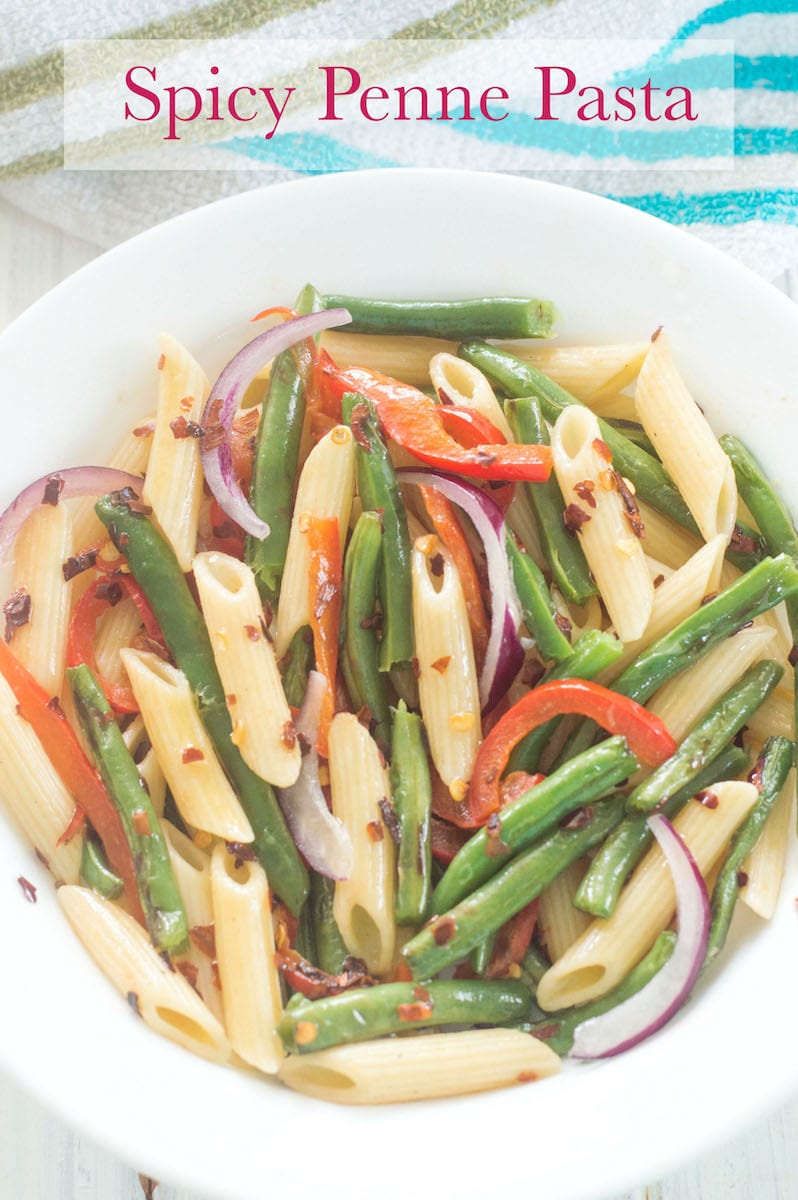 Overhead view of a plate with Penne Pasta, Green Beans, Bell Pepper and Onions