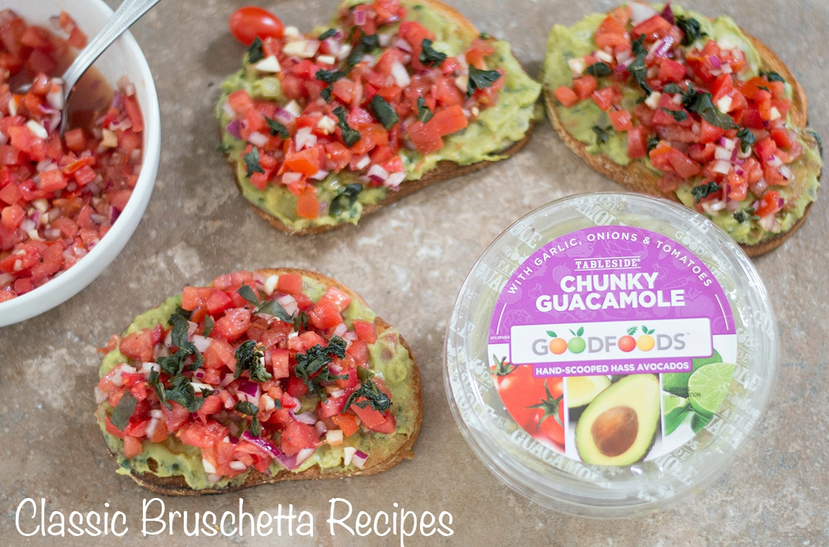 Overhead view of 3 bruschetta gaucamole, a white bowl with bruschetta and one container of chunky guacamole