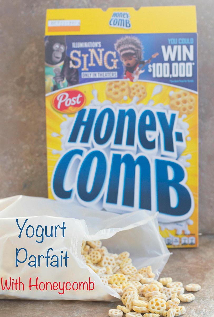 Contents of the honey-comb cereal spilled out and the cereal box in the background