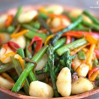 Gnocchi brown buttered in vegan butter + fresh rosemary. Add roasted asparagus + sweet red peppers. Mix with a dirty vinaigrette. Best 30 minute meal ever!