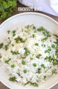 Overhead view of a white bowl with coconut rice and peas