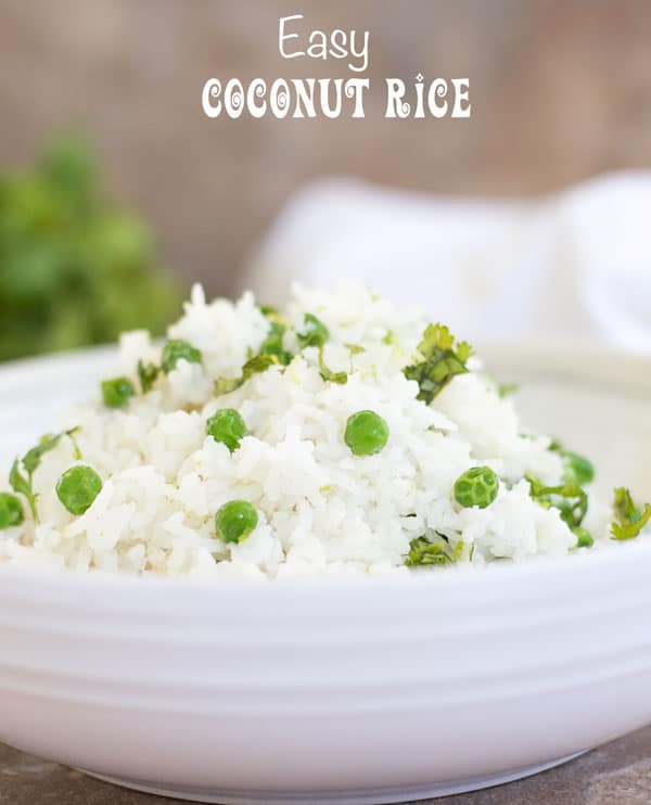 Front view of a white bowl with coconut rice and peas
