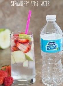 Summer Cleansing Water using strawberries and green apples