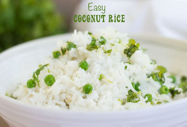 Portrait view of a white bowl with coconut rice and peas