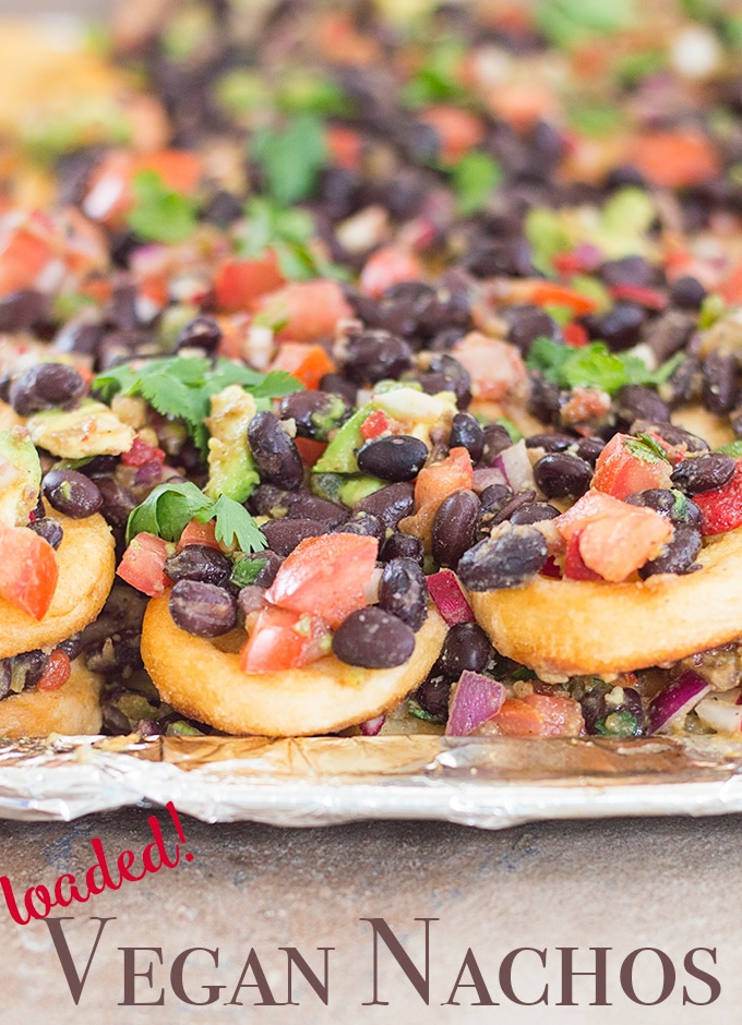 Side View of Smiles Nacho Layered on Top of a Baking Tray with Beans and Veggies