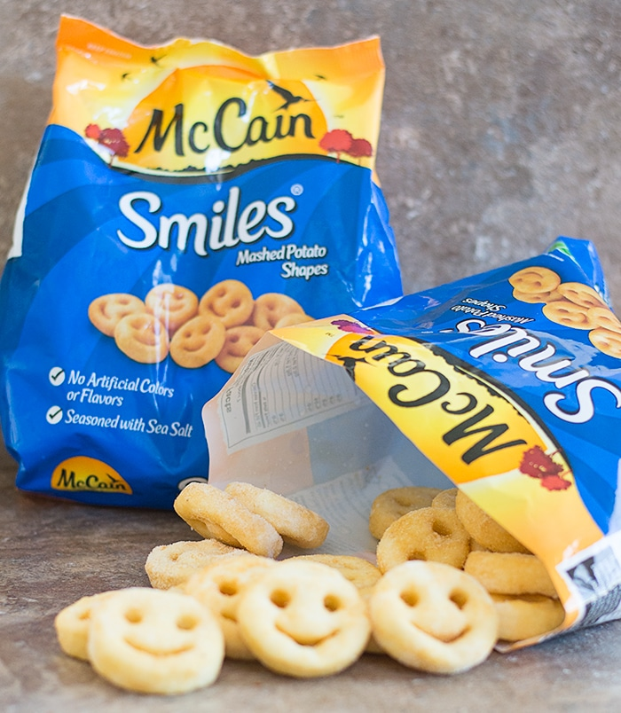 2 McCain Smiles Package Where One is Open and McCain Smiles Spilling Out of it