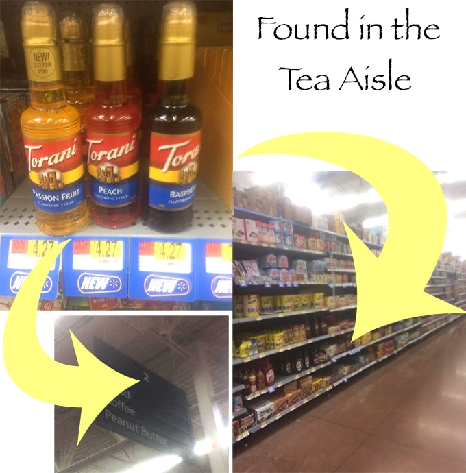 "Collage of 3 Photos. First Photo on the Top Left is of Three Torani Syrup Bottles on the Shelf at Walmart With a Blue Label Price Tag Showing the Price $4.27 Under Each Bottle. There is a Yellow Arrow Pointing to the Second Image at the Bottom Which is of Aisle Number 2. There is Another Yellow Arrow Pointing to the Third Photo on the Bottom Right. The Image is of the Whole Aisle at Walmart and the Tip of the Arrow is Pointing to the Specific Location on the Shelf Where the Item is Located. On the Top Left of the Image, There is a Title for the Image Which Says, ""Found in the Tea Aisle"""