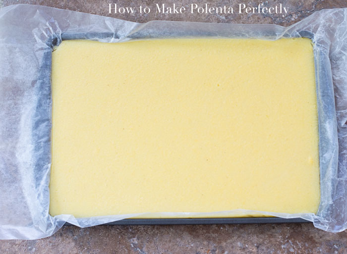 Overhead View of a Baking Tray Lined With Parchment Paper and Filled With Cooked Polenta