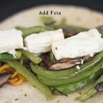 Top Souvlaki with the Grilled Feta