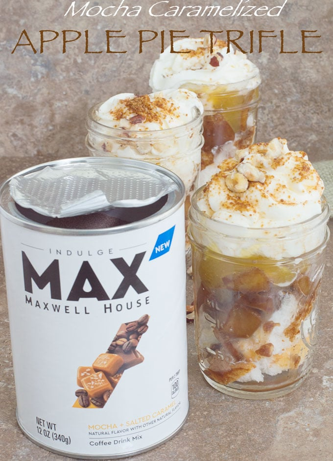 Front view of MAX Coffee Container and 3 apple pie trifle in mason jars arranged diagonally. Cinnamon stickes, hazelnut and cubed Angel Food cake surround the jars