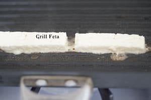 Feta placed on a griddle - Souvlaki