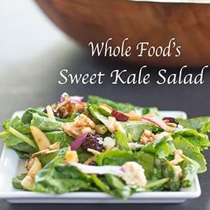 Front View of Small Square White Plate Filled With Whole Foods Kale Salad