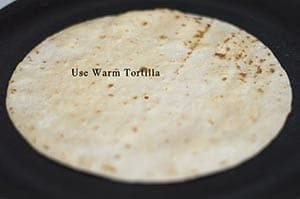 A tortilla placed on a griddle