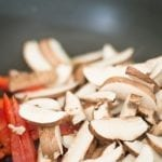 Button Mushrooms and Red Bell Pepperin Stir Fry Pan