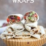 Front View of Five Wraps Placed on a Wooden Board. One Wrap is Cut Into Half and placed on Top - 2 Back-To-School Recipes
