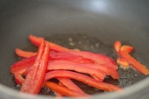 Red Bell Pepper Strips in Stir Fry Pan