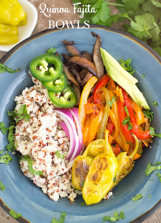Vegan quinoa fajita bowls meal prep healing tomato recipes overhead view of a dark blue plate filled with quinoa on the left on the forumfinder Choice Image