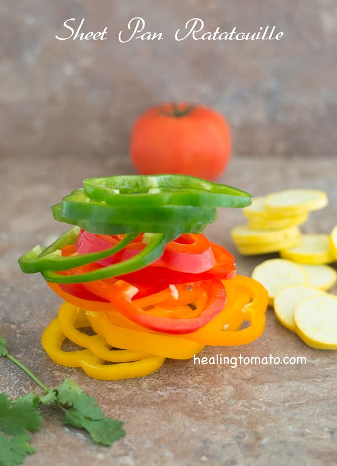 Front View of All Colors of Bell Peppers Cut Into Rings and Stacked on Top of Each otehr - Sheet Pan Ratatouille