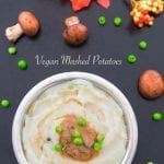 Overhead view of vegan mashed potatoes with gravy and peas in the middle - Vegan Dumplings Soup
