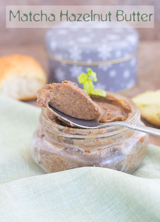 Front view of Spoon with Matcha Hazelnut Butter Sitting On a Small Mason Jar