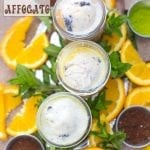 Overhead view of 3 Mason Jars filled with 3 different types of affogato and surrounded by orange slices, coffee, matcha powder and mint leaves