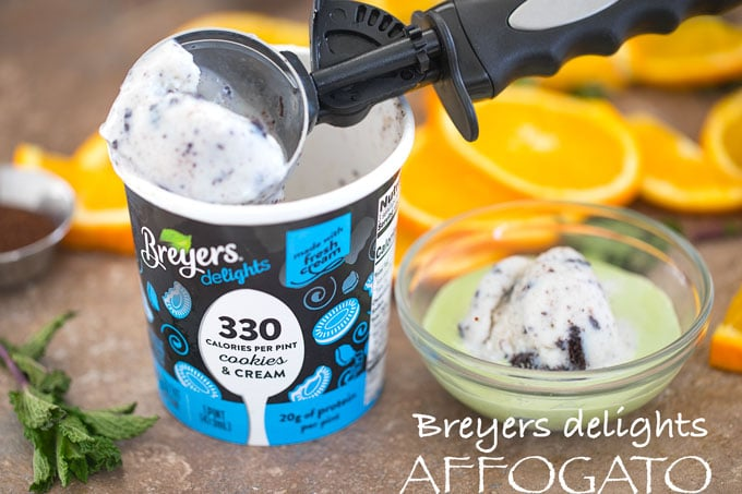 Front View of an ice cream Scooper resting on top of a pint of breyers delights pint and a bowl with matcha affogato next to it