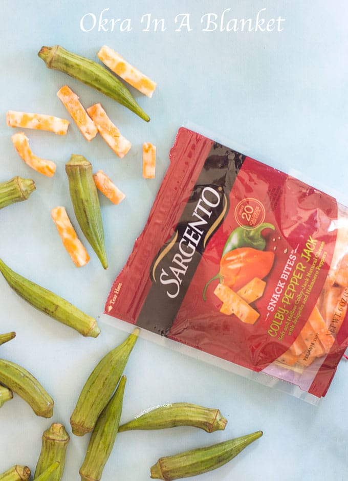 Front View of Sargento Snack Bites Cheese Packet Surrounded by the Cheese and Okra - Okra in a blanket