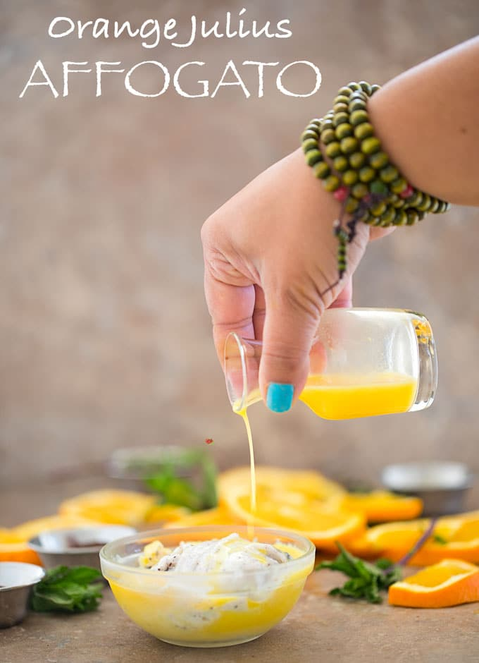 Front View of the Author Pouring Orange Julius into a bowl of Ice cream - Orange Julius Affogato