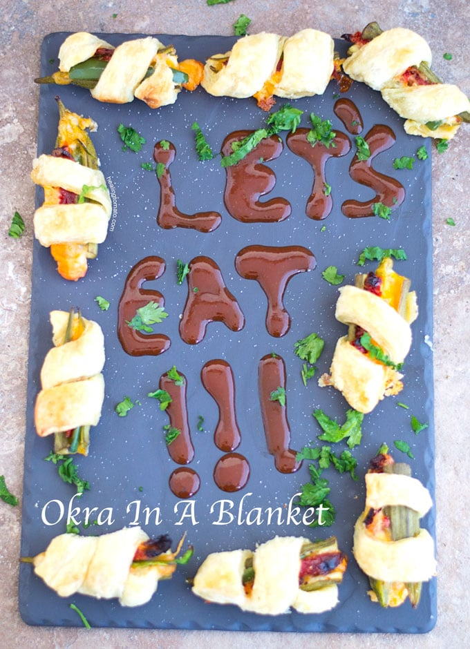 Front View of A Plate of Okra Wrapped with Puff Pastry and filled with Sun-dried Tomatoes, Jalapeno and Sargento Snack Bites Cheese - Okra in a blanket