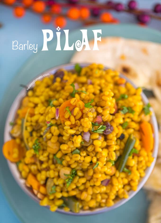 Overhead View of a Copper Bowl Filled to the Top with Barley Pilaf Recipe with Naan on the side