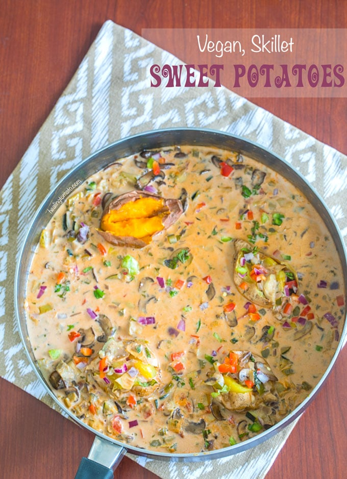 "Overhead view of a 12"" fry pan with bright vegetables and baby sweet potatoes in a creamy pink sauce - Skillet Sweet Potatoes"