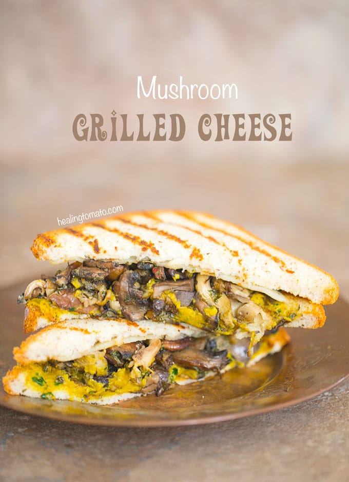 Front View of two Mushroom Grilled Cheese cut into Triangle shapes.