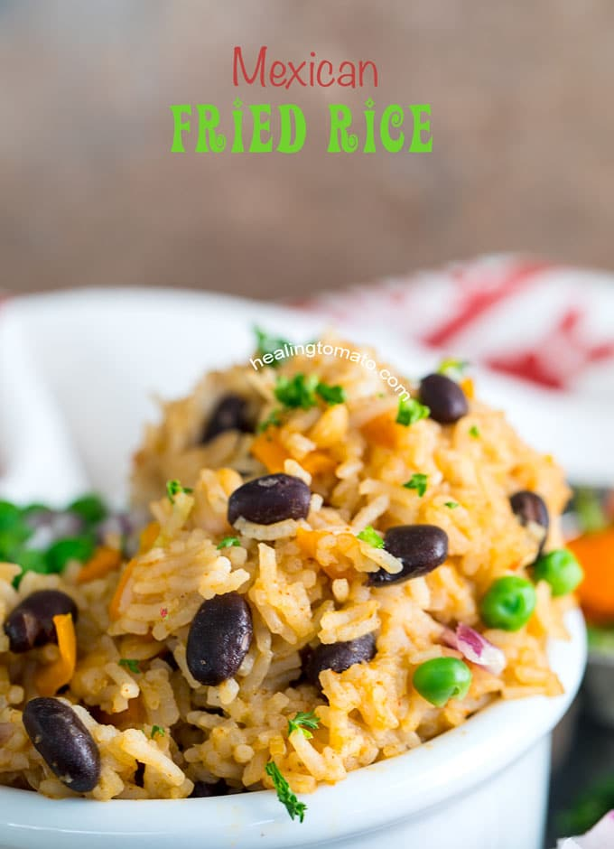 Closeup Front view of Mexican Fried Rice with black beans and peas in a white bowl