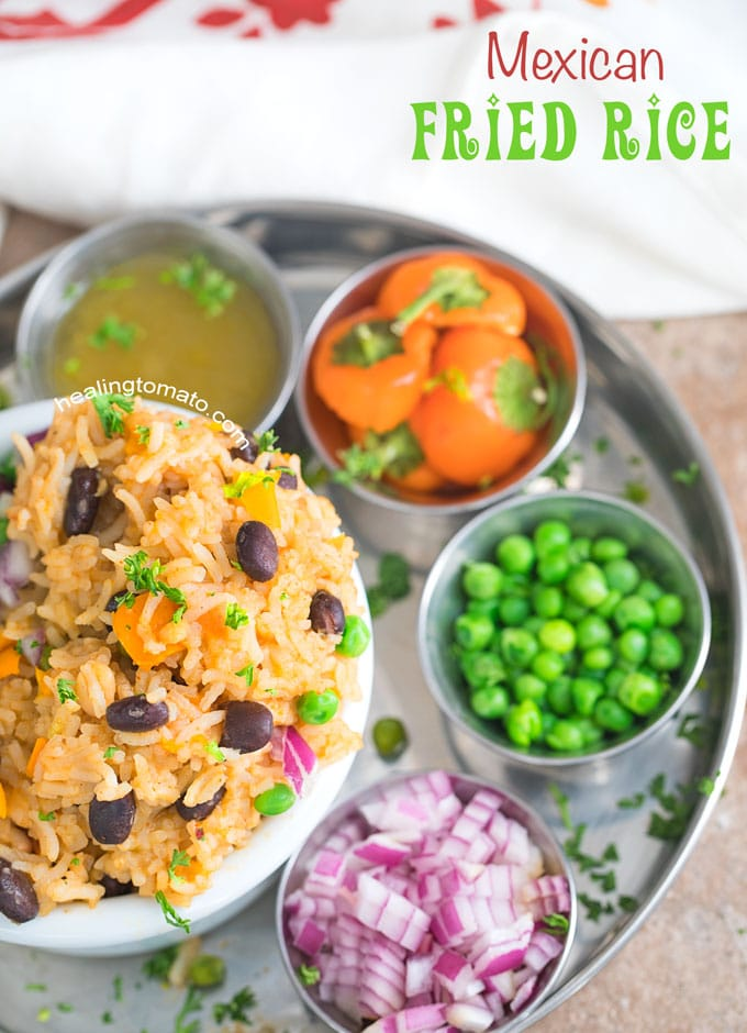 Overhead Viewo of Mexican Fried Rice in a white bowl served with a side of peas, red onion or tomatillos.