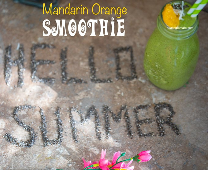 "Overhead veiw of a brown tile with ""Hello Summer"" written out in chia seeds and a glass bottle with green smoothie on the side"