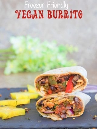 Front view of a Vegan Burrito cut into half and stacked. Surrounded by cut carambola