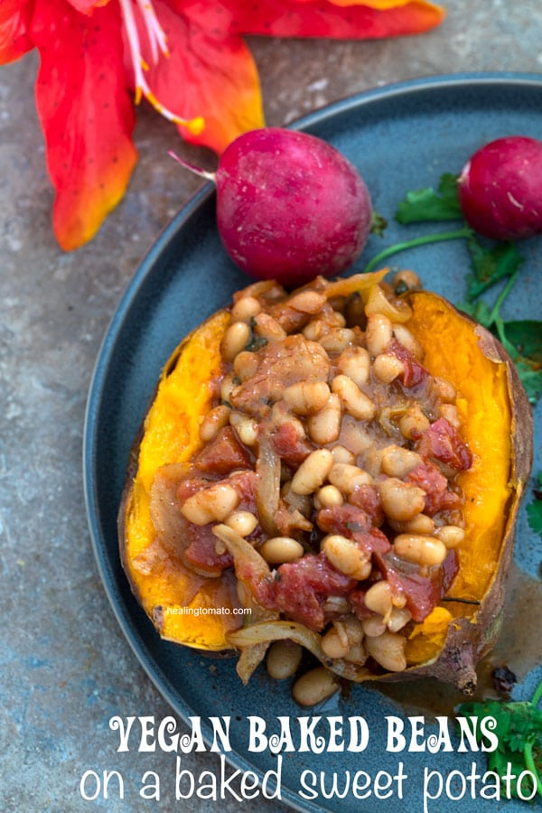 Overhead view of vegan baked beans on a baked sweet potato filled with stove top baked beans