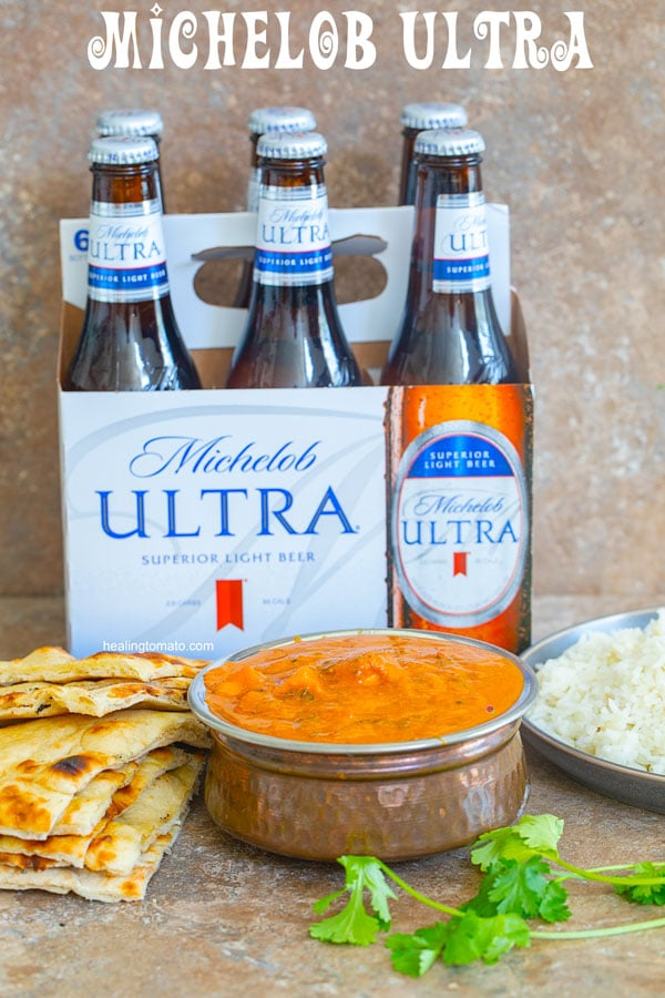 Front View of a few Indian dishes and a 6-pack of Michelob Ultra Bottles - 5 Ways to Spend Father's Day Without a Father